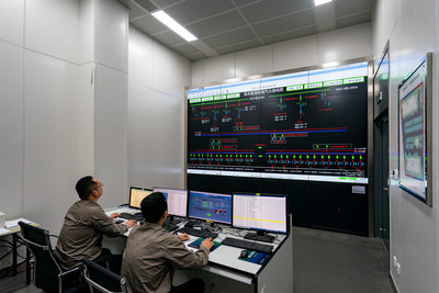 Photo: Staff of State Grid Suzhou Power Supply Company starts power transmission of No. 1 converter valve for Pangdong central station on June 29, 2021 in Suzhou, east China's Jiangsu province.